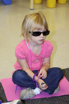 ava-in-sunglasses-sitting