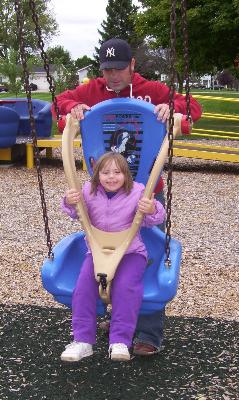bliss-boundless-2007-swinging-male-teacher-female-child